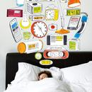 image of man sleeping with illustration of many different types of alarm clocks above him