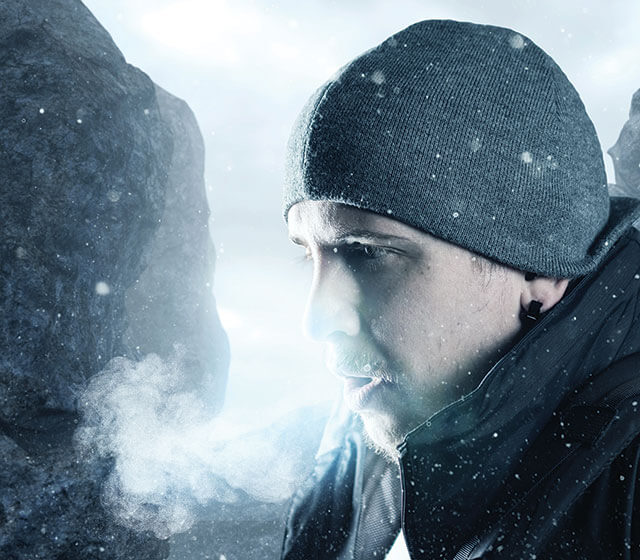 man breathing in the cold air